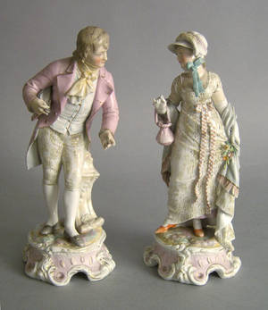 Pair of porcelain figures of a man and woman