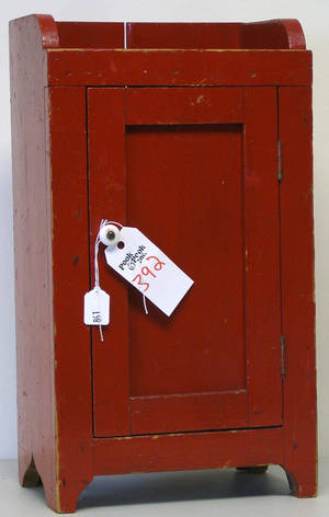 Red painted childs cupboard