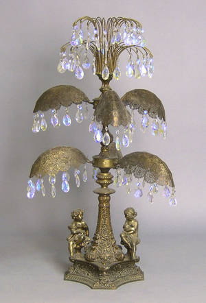 Large brass table lamp with cast figures of children and glass prisms
