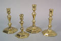 Four Queen Anne brass candlesticks mid 18th c