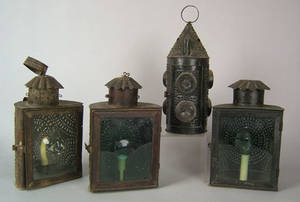 Four punched tinned sheet iron lanterns early 19th c