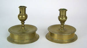 Two similar Spanish brass candlesticks ca 1620