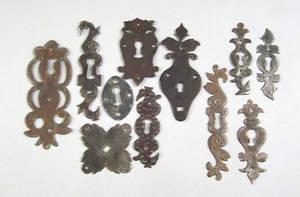 Eleven Pennsylvania wrought iron escutcheons 18th c
