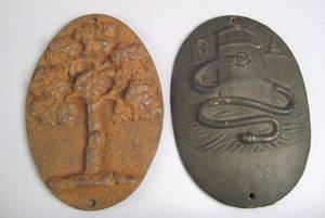Two cast iron fire marks 19th c