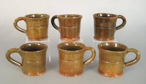 Set of six Thomas Stahl redware mugs dated 1939