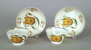 Pair of pearlware cups and saucers early 19th c