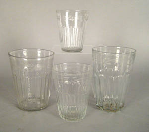Four blown colorless flip glasses early 19th c