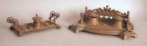 Two Victorian brass inkwells