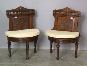 Pair of Victorian carved piano chairs