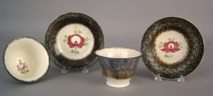 Two black and brown rainbow spatter cups and saucers 19th c