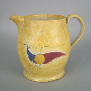 Yellow spatter pitcher 19th c
