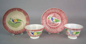 Two red spatter cups and saucers 19th c