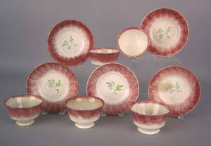 Five red spatter cups and saucers 19th c