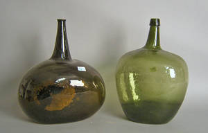 Two green blown glass bottles