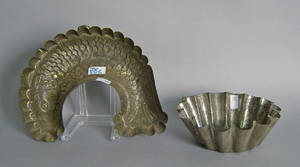 Two tin molds