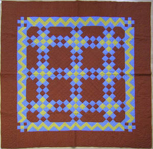 Pennsylvania red yellow and blue calico quilt early 20th c