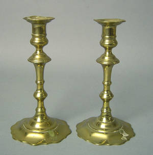 Pair of Queen Anne brass push up candlesticks mid 18th c