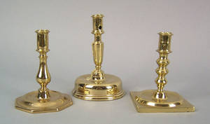 Three Spanish brass candlesticks late 17thearly18th c