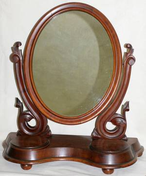 081051 GEORGE III WALNUT OVAL DRESSING MIRROR