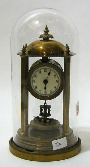 Brass mantle clock with glass dome