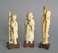 Three carved ivory figures