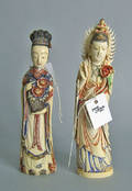 Two painted and carved ivory figures of women