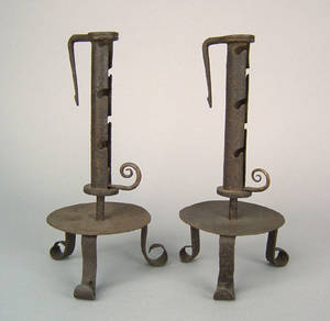 Pair of wrought iron side ejector candlesticks 19th c