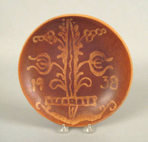 Pennsylvania redware charger dated 1938 attributed to Thomas Stahl