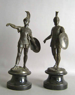 Pair of white metal statues of Roman soldiers