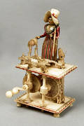 Prisoner of war carved bone model of a woman sewing 19th c