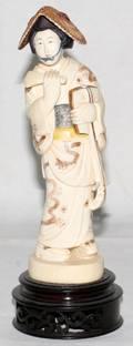 061253 JAPANESE IVORY  POLYCHROME FIGURE OF A WOMAN