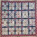 Pieced calico quilt with squares of stars and triangles late 19th c