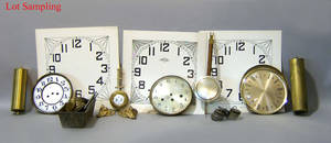 Large group of misc clock parts to include dials and pendulums