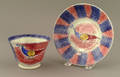 Blue and red rainbow spatter cup and saucer 19th c