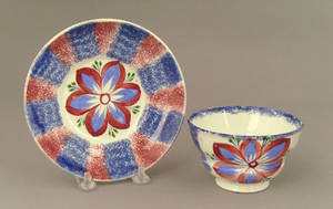 Red and blue rainbow spatter cup and saucer 19th c