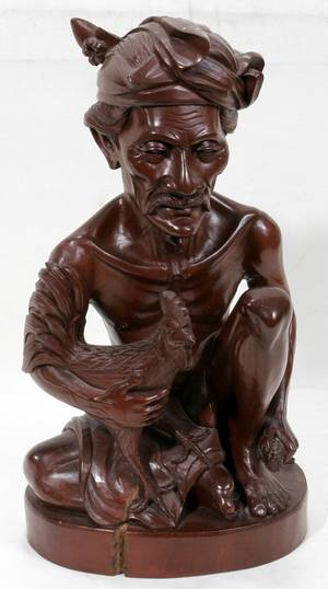 042427 INDONESIAN CARVED WOOD FIGURE OF A MAN