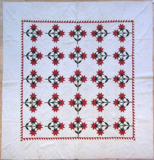Pieced red and green calico quilt late 19th c