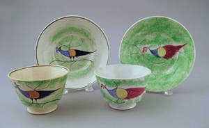 Two green spatter cups and saucers 19th c