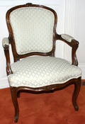 102317 LOUIS XV STYLE CARVED WALNUT OPEN ARMCHAIR