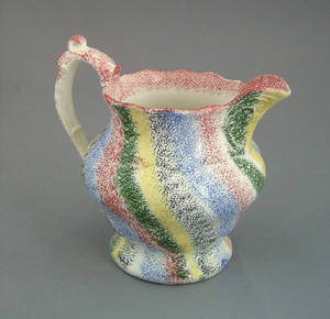 Five color rainbow spatter pitcher 19th c