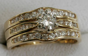 121428 14KT YELLOW GOLD  DIAMOND WEDDING RING SET