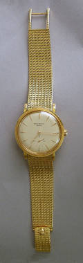 Patek Philippe 18K gold wristwatch with 24K gold rotor and matching 18K gold mesh strap