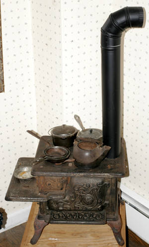 092368 MODEL CAST IRON STOVE W VARIOUS ATTACHMENTS