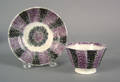 Small purple and black rainbow spatter cup and saucer 19th c