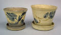 Two Pennsylvania stoneware flowerpots and undertrays late 19th c