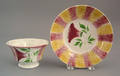 Yellow and red rainbow spatter cup and saucer 19th c
