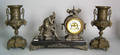 French spelter clock garniture with open escapement