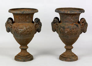 Pair of cast iron garden urns late 19th c