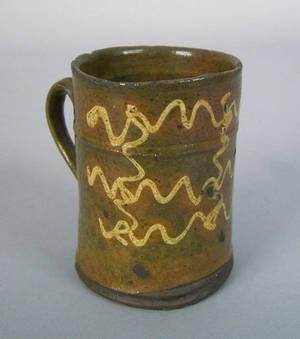 Pennsylvania redware mug ca 1800