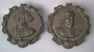 Pair of cast iron plaques ca 1880